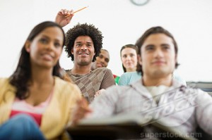 College Student Raising Hand During Lecture